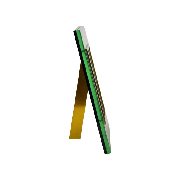 Picture frame by Fontana Arte mod. n. 2426 designed in 1970s with ground crystal, colored crystal, brass frame. Published in Catalogue Fontana Arte, 1972. Dimensions of the frame: 17.5 x 12.5 cm.