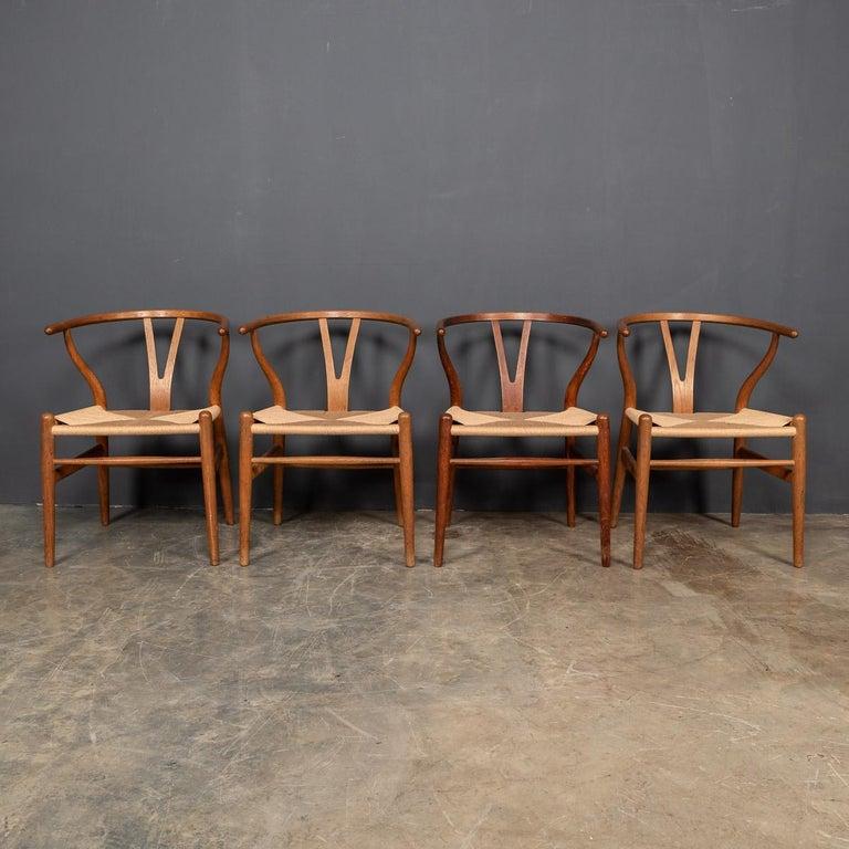 Danish 20th Century Four Wishbone Dining Chairs by Hans J Wegners, circa 1960 For Sale