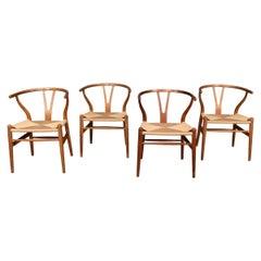 20th Century Four Wishbone Dining Chairs by Hans J Wegners, circa 1960