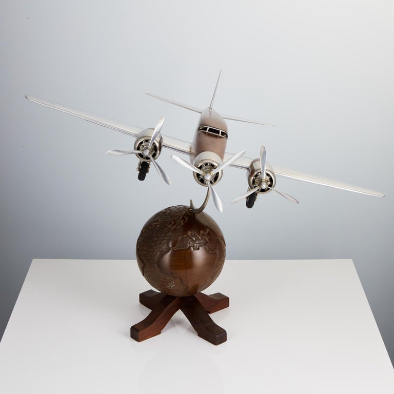 A very decorative 20th century French Art Deco model of an aircraft mounted on a world globe, French, circa 1930.