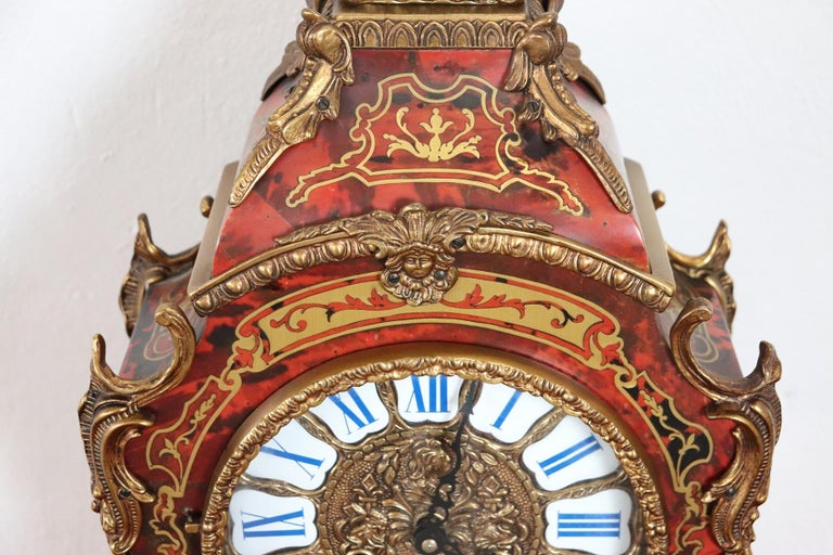 Rare and fine quality French Louis XV style boulle, circa 1920s red tortoiseshell and brass inlaid table clock. The clock has very good quality bronze gilt ormolu mounts. Perfect condition.
