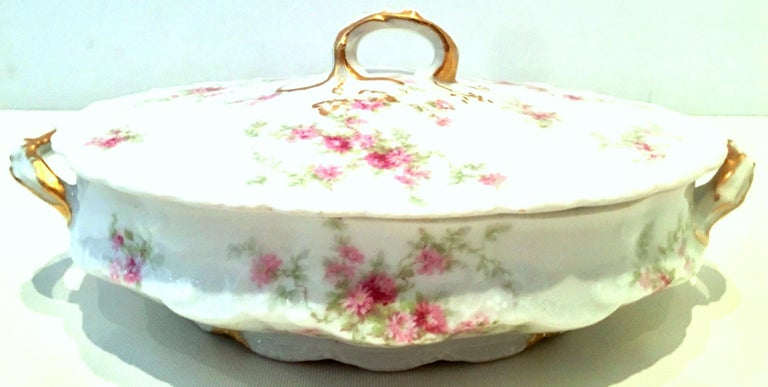 20th century French limoges porcelain and 22-karat gold set of three serving pieces by, Theodore Haviland. Set features a bright white ground with scalloped shape detail, hand painted in a bright pink and green flowing rose rose with hand painted