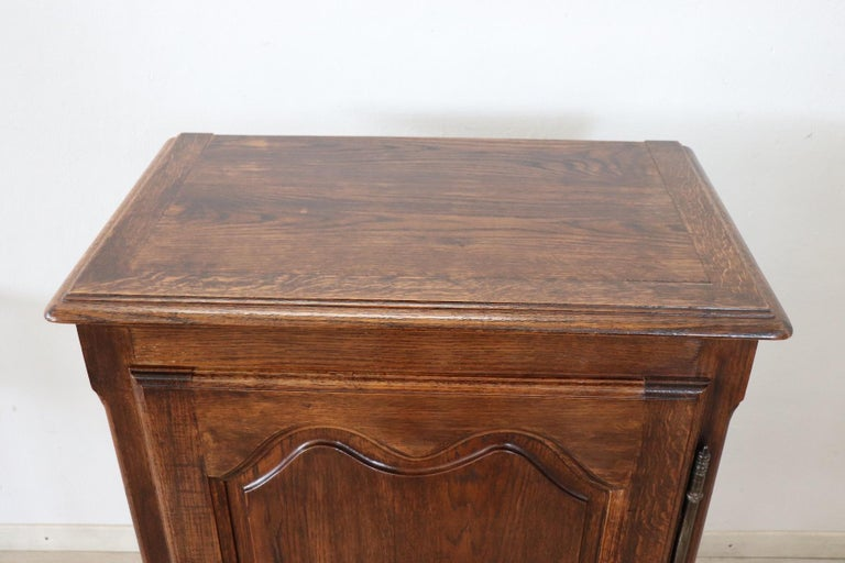 Particular small sideboard or cabinet in solid oakwood. In perfect French Louis XIV style with wavy legs. On the front one door with internal two shelfs. The internal shelfs can be moved as desired. This furniture is used but in perfect condition