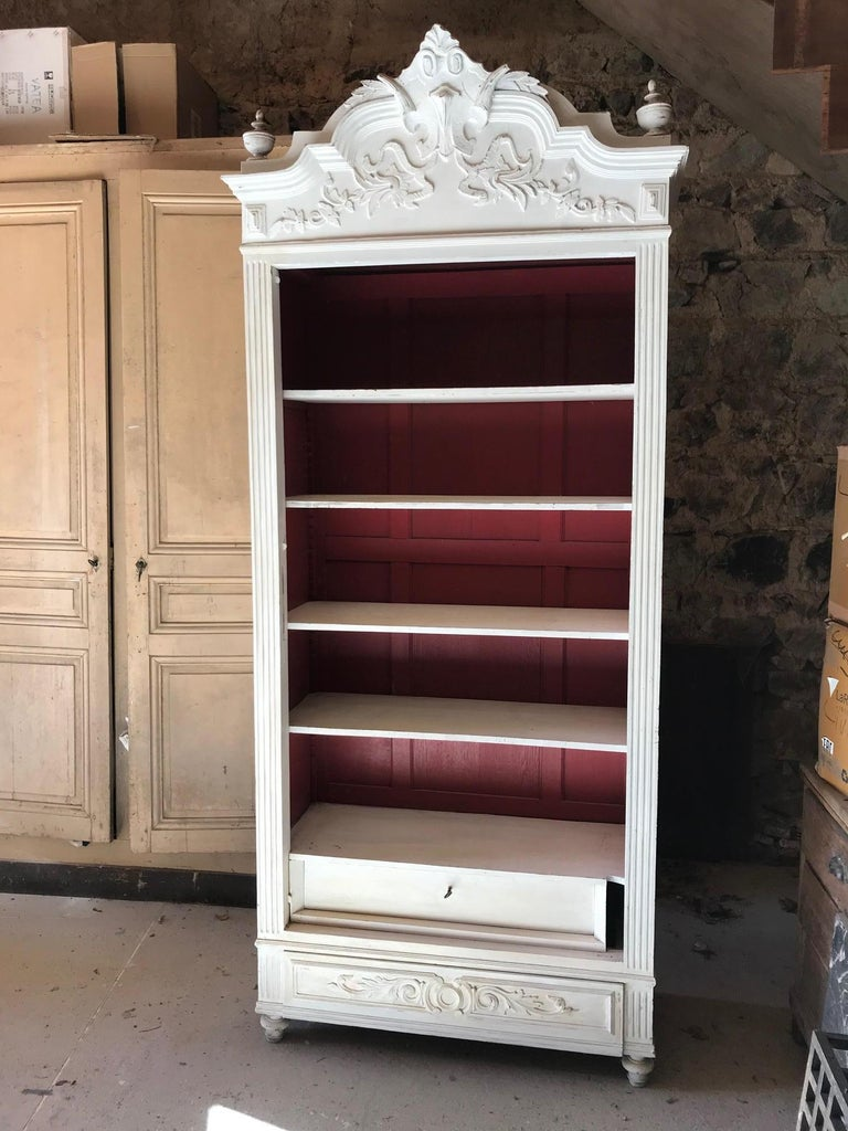 Beautiful 20th century French Louis XV style painted Armoire, wardrobe.  Painted in white on the outside and red on the inside.  Two drawers on the bottom of the armoire. Removable cornice.  Many shelves. There is no door.