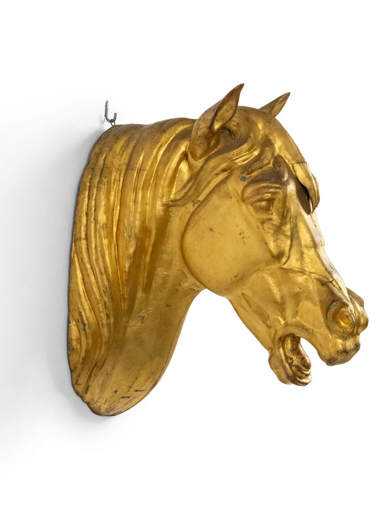 French Provincial wall plaque composed of gilt metal cast in the form of a mounted horse head.
