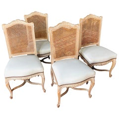 20th Century French Set of Four Hand Carved Dining Chairs with Tall Cane Backs