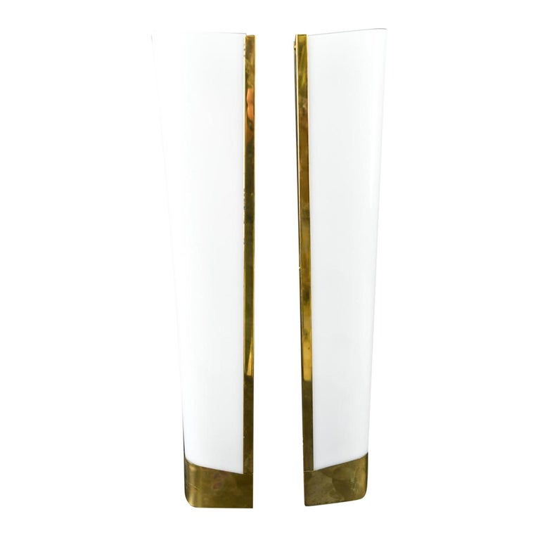 A vintage Art Deco set of six French wall sconces made of hand crafted brass and lucite glass. Each of them is featuring a one light socket, in good condition. The wires have been renewed. Wear consistent with age and use, Circa 1940 - 1950, Paris,