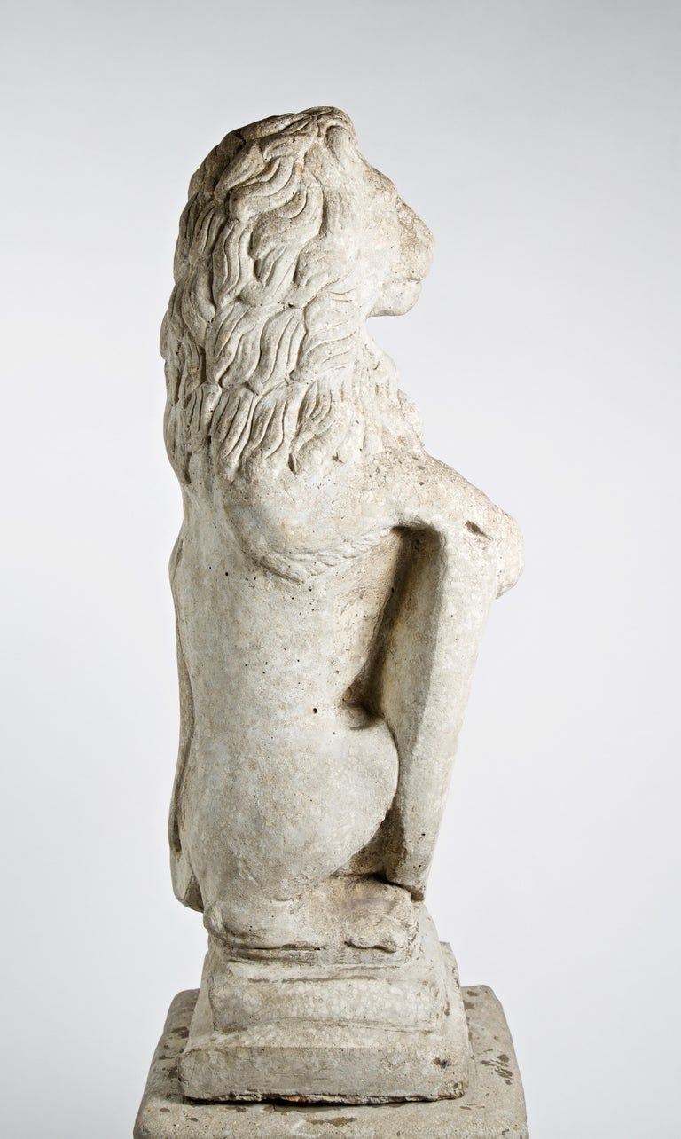 20th Century French Stone Lion with Shield on Pedestal In Good Condition For Sale In Los Angeles, CA