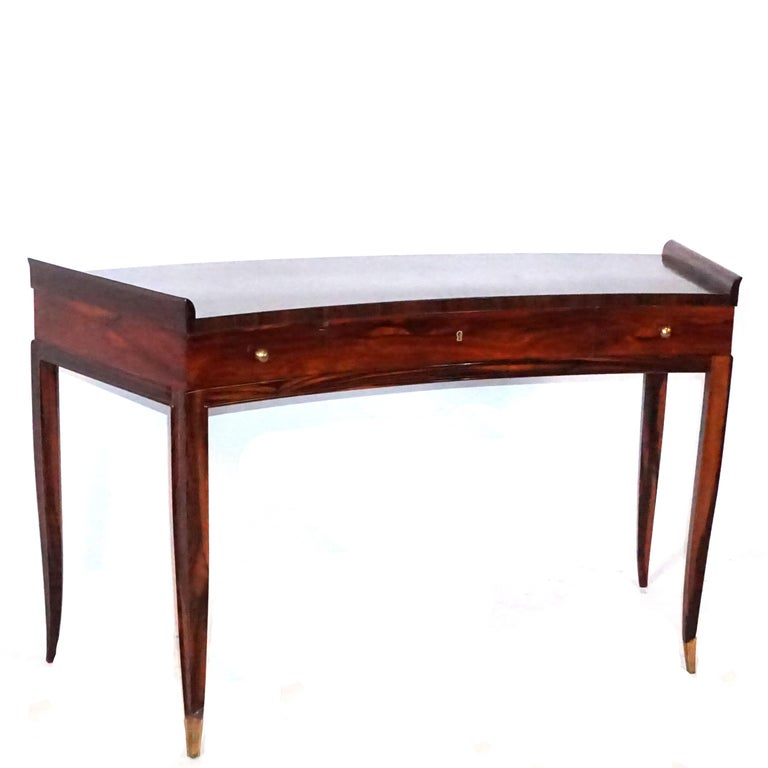 A vintage French Art Deco curved back writing desk made of hand carved Rosewood with elegant legs and gilt bronze sabots, in good condition. Wear consistent with age and use, circa 1940, France.