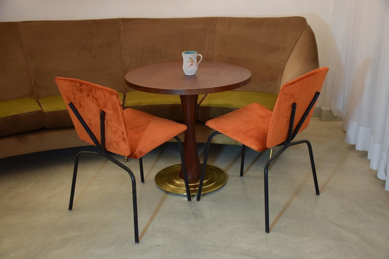 Pair of French 20th century vintage chairs composed of a tubular black lacquered steel structure with an original v shaped back. The chairs have been re upholstered with a Lelièvre Paris vibrant orange velvet, one of the highest quality French