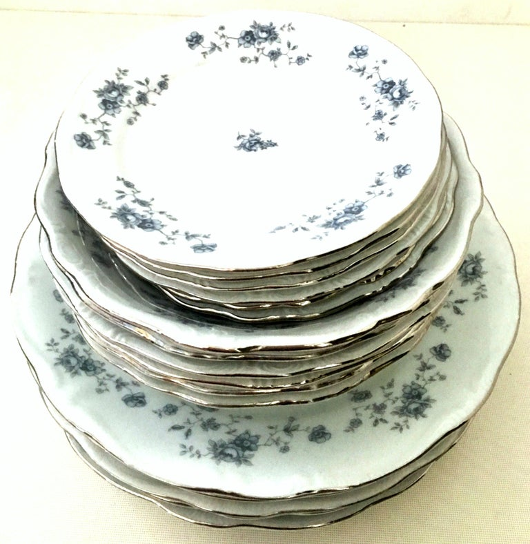 20th century German Porcelain and platinum dinnerware set of 18 by Johann Haviland. The blue Garland pattern features a bright white ground with blue floral motif, scallop and raised edge and silver platinum rim. This 18-piece set includes, six
