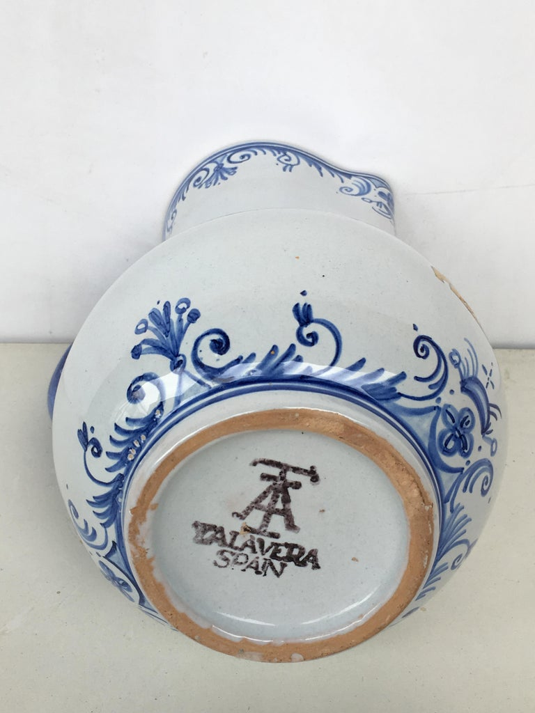 Spanish 20th Century Glazed Earthenware Blue and White Painted Pitcher, Signed Talavera For Sale