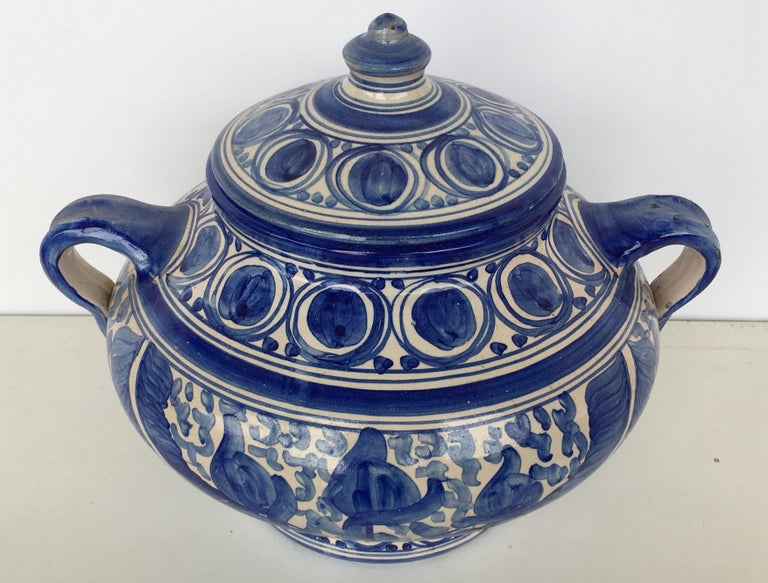 A striking Spanish glazed earthenware blue and white painted urn with cover, the body underglaze blue & white ornamental decorated very tipycal of this region.  Talavera de la Reina pottery is a craft made in Talavera de la Reina, Toledo (Spain).