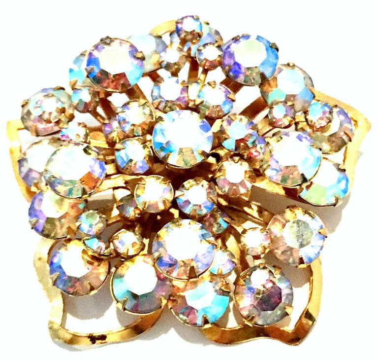 20th Century Gold Plate & Austrian Crystal Dimensional Floral Brooch. This finely crafted gold plate and brilliant cut and faceted Aurora Borealis Austrian Crystal fancy prong set brooch features a multi dimensional abstract floral form.