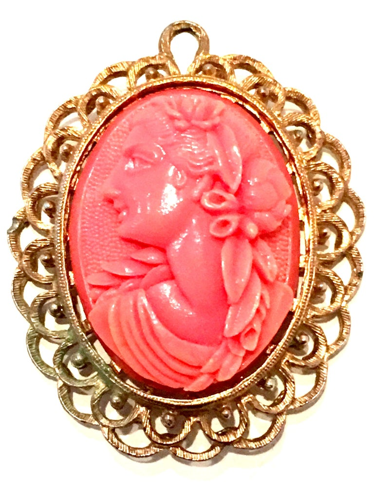 20th Century Gold & Carved Lucite Pink Coral Cameo Necklace Pendant & brooch. This finely crafted glad plate with highly carved Lucite pink coral cameo features a left facing female subject.