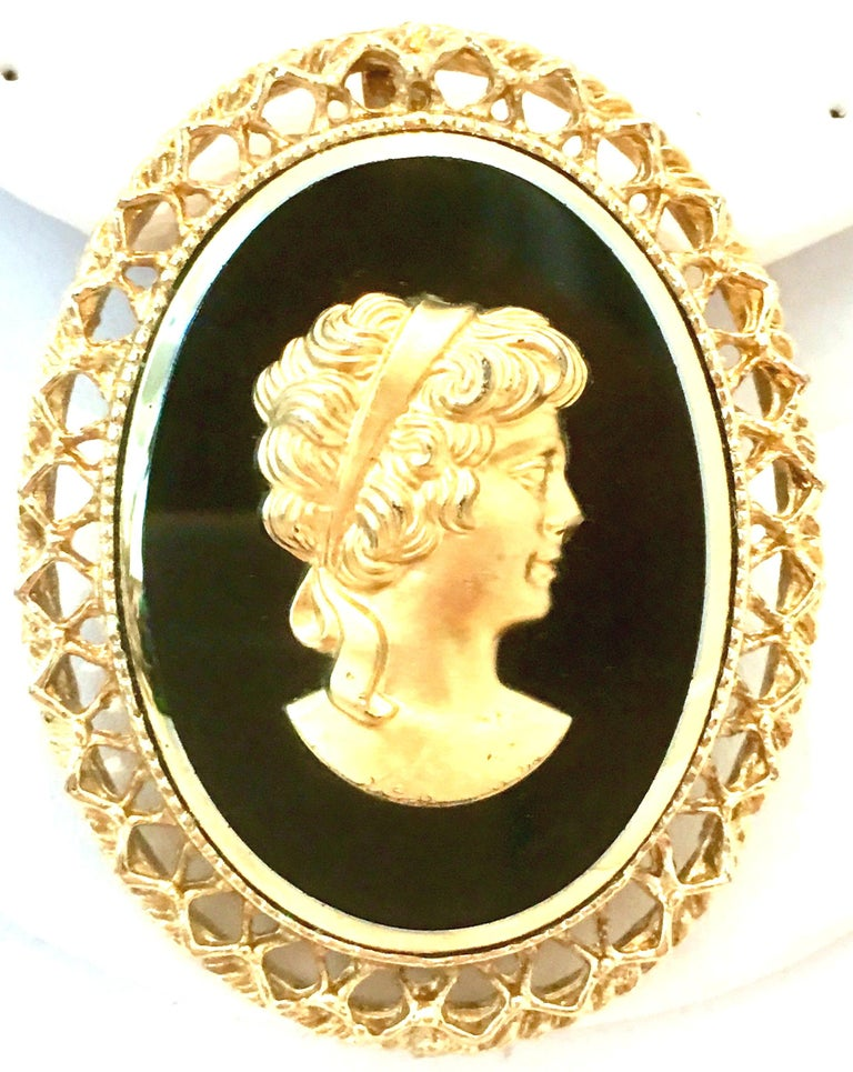 20th Century Gold Plate Cut Glass & Gold High Relief Cameo Brooch & Necklace Slide. This charming right facing woman gold cameo sitting atop a black cut glass bezel set cameo can be used as a pendant necklace enhancer and or a classic brooch.