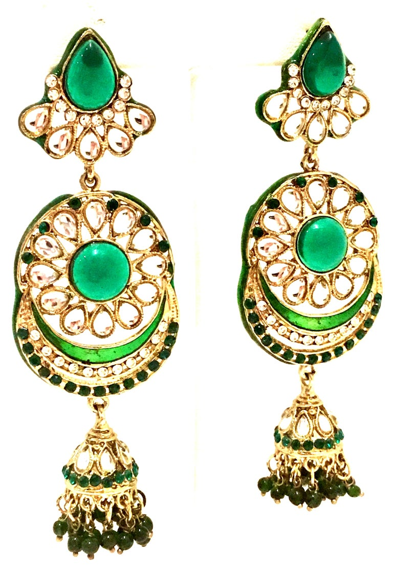 20th Century Pair Of Gold, Austrian Crystal, Enamel, Resin Bead And Molded Glass Chandelier Earrings. These dramatic gold plate Maharaja style 4.25