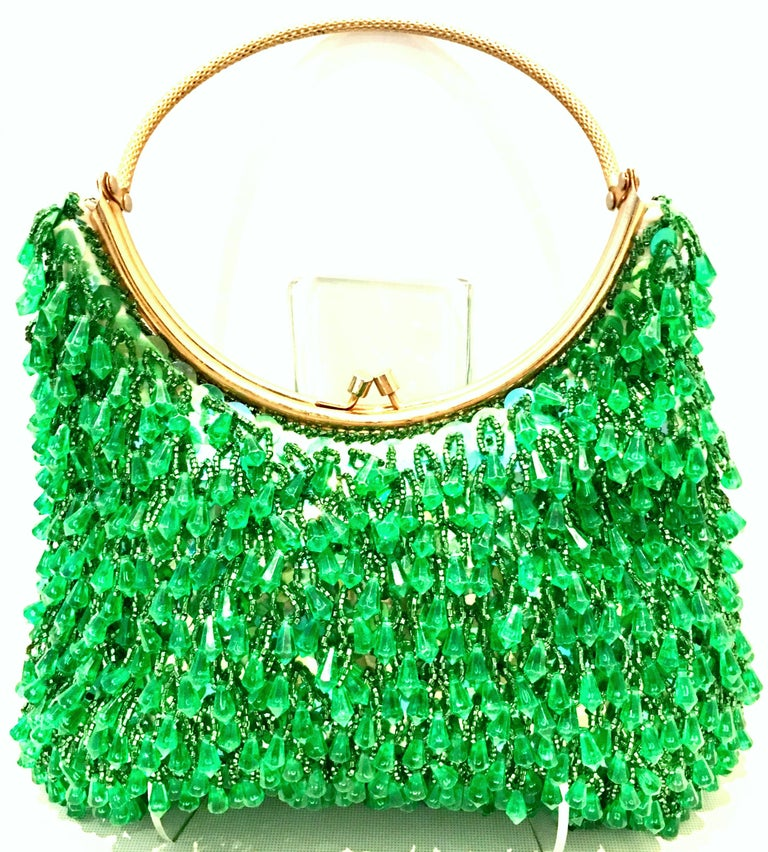Mid-20th Century Gold Plate, Crystal Bead & Sequin Evening Bag By, Richere-Hong Kong. This coveted and rare hand bag features a gold gilt brass round handle with vibrant green crystal beads and iridescent green sequins. Fully lined in satin with one