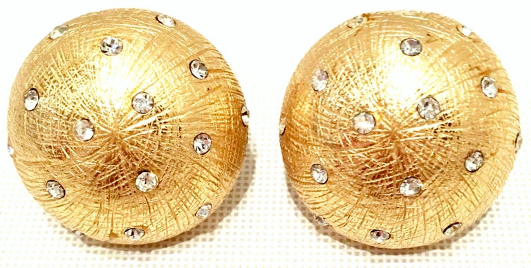 20th Century Brushed Gold Plate & Swarovski Crystal Clip Style Earrings By, Christian Dior. These Dior brushed gold plate with diminutive brilliant crystal clear Swarovski stones are a mushroom cap shape and both signed on the underside, Christian