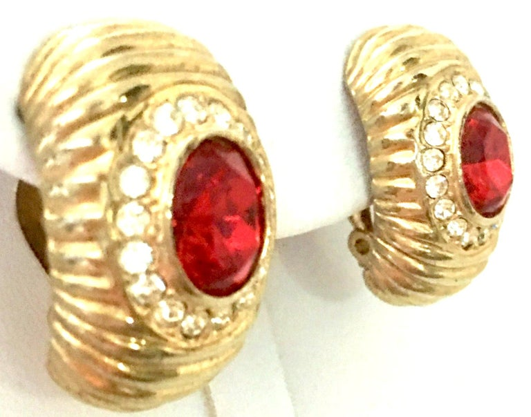 Women's or Men's 20th Century Gold & Swarovski Cry stal Earrings By, Christian Dior For Sale