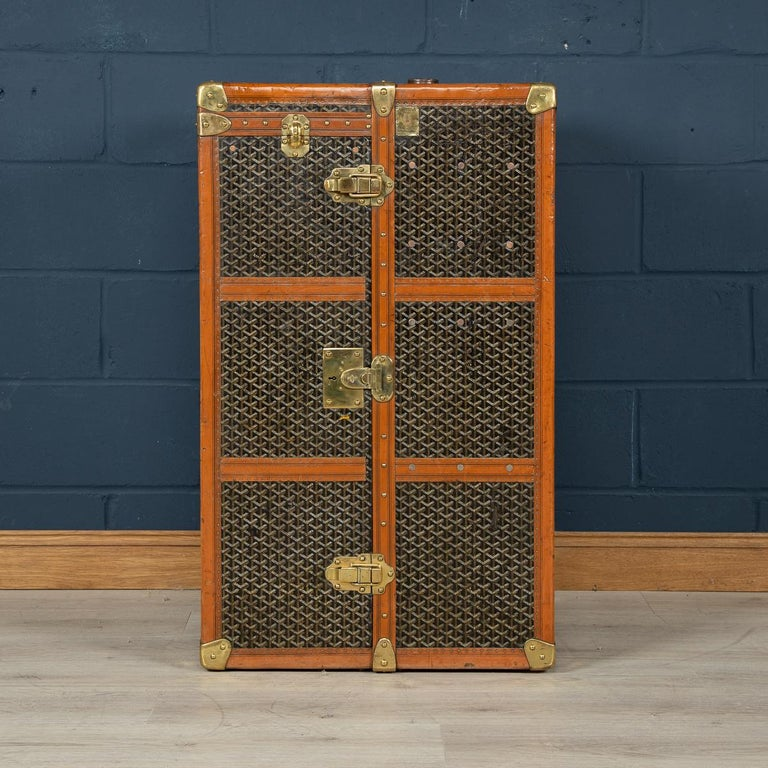 A huge Goyard wardrobe trunk in fabulous condition, completely original and with great character, opening (with a flip top cover) to reveal a hanging compartment to the left and a set of drawers to the right hand side. Dating to the early part of