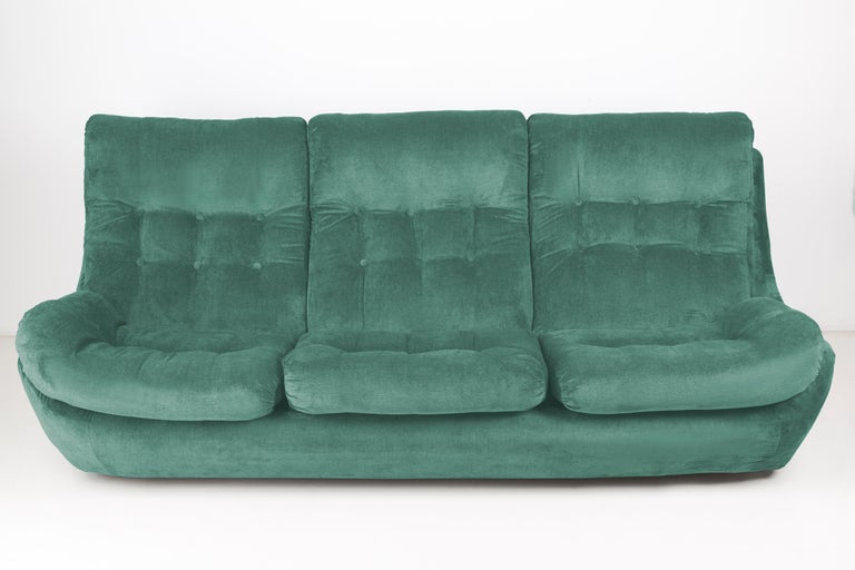 Atlantis sofa from the 1960s, produced in Czech Republic - at the moment they are unique. Due to their dimensions, they perfectly fits apartments providing comfort and beautiful decoration. Covered with high-quality velvet fabric, a space-saving