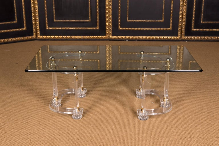 Exclusive acrylic coffee table with two glass panels with gold colored frame.  Made in Italy.  Light surface scratches, otherwise good condition  Please take a look at the detailed pictures. Measurements. Length:135cm  Widht:75 cm.