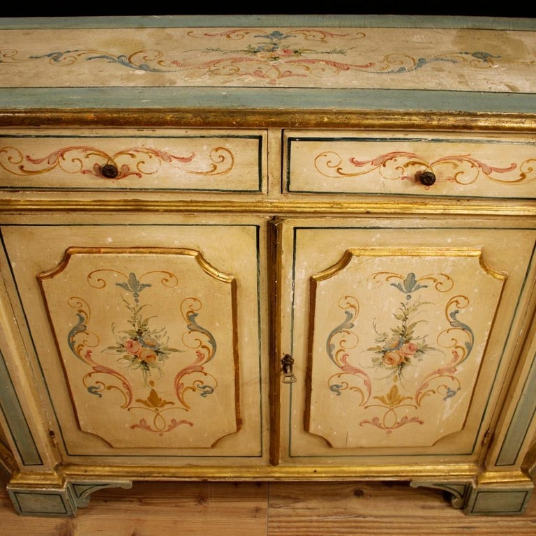 Venetian sideboard from 20th century. Nicely carved, gilded and painted wooden furniture in neoclassical style. Sideboard of nice line and excellent proportion, it can be easily placed in different parts of the house. Furniture equipped with two