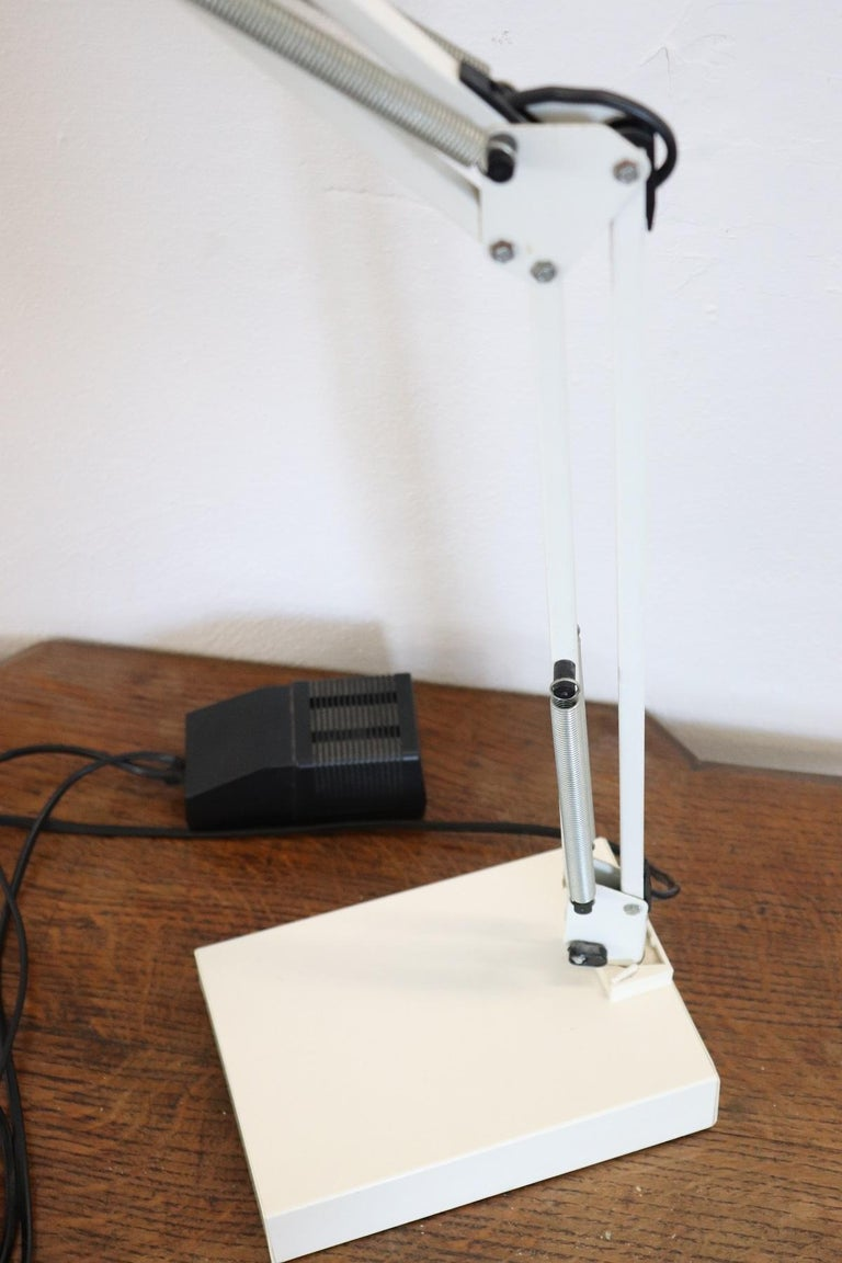 Industrial Design Adjustable Table Desk Lamp by Luxo, 1980s. Perfect for your bedside table or your desk. Metal lamp in white color. Fluorescent light. It is possible to move the body at will to direct the light. Visible internal label. Very