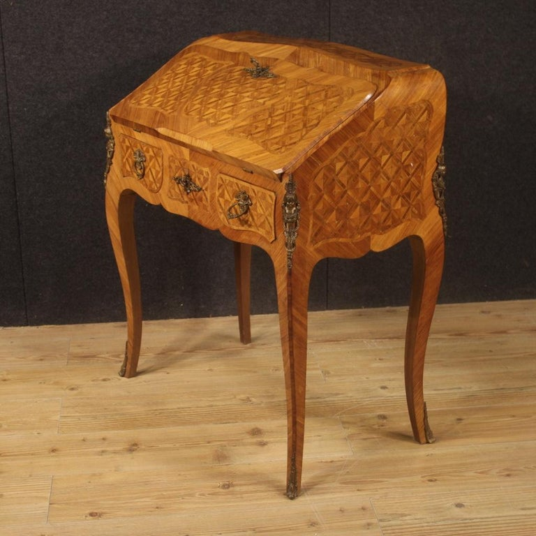 French bureau in the mid-20th century. Furniture adorned with geometric inlay in rosewood, walnut, mahogany and fruitwood. Bureau fitted with two external drawers of good capacity, closable with a special key (central lock). Inside complete with