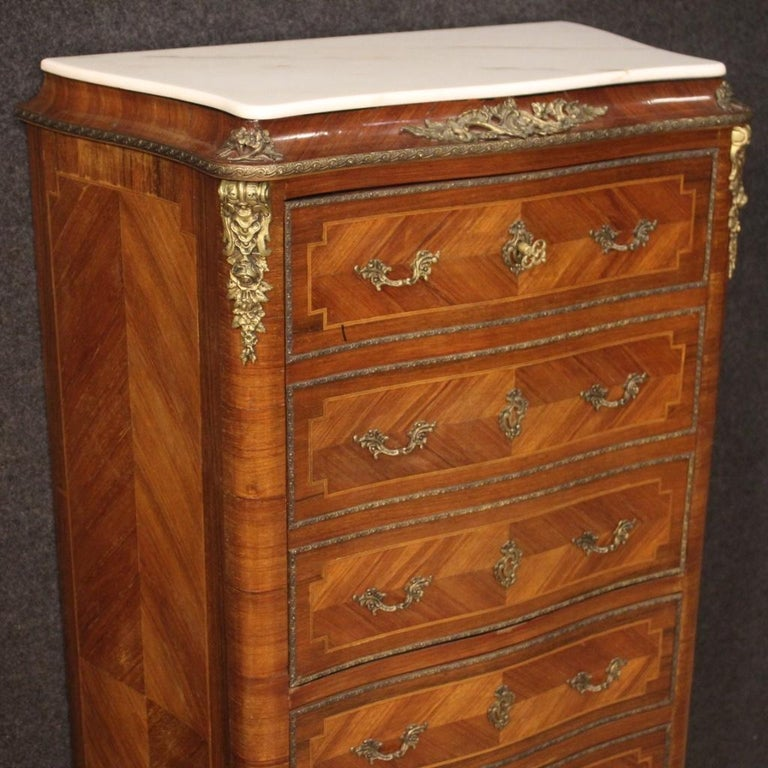 French secrétaire from the mid-20th century. Furniture inlaid in walnut, mahogany, maple and fruitwood richly adorned with gilded and chiseled bronze and brass. Secrétaire equipped with four external drawers (lower part) and fall-front (complete