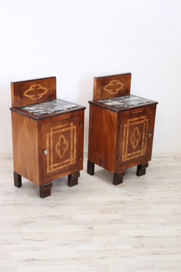 Rare Italian Art Deco pair of nightstands. Made of fine walnut with refined inlaid decoration. Dark gray Italian marble top.