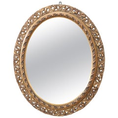 20th Century Italian Art Nouveau Carved and Gilded Wood Oval Wall Mirror