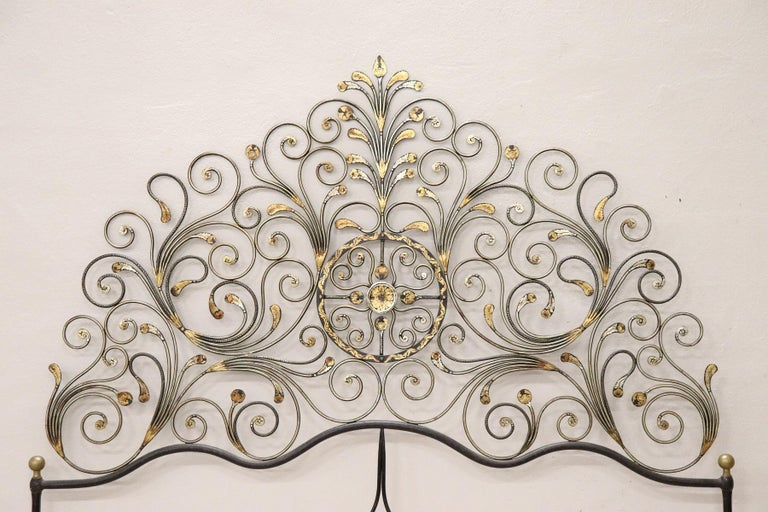 Italian Baroque style bed frame. Rich double bed headboard in gilded wrought iron. Great woodwork with lots of curls and swirls of typical Italian Baroque taste. This type of beds in Italy were typical of the city of Genoa and were called peacock