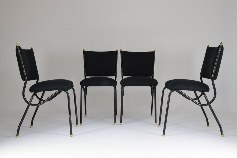 A beautiful set of five Mid-Century Modern dining chairs designed in curved black lacquer tubular steel with a brass detailed structure by Studio BBPR circa 1950s. The upholstery is entirely restored in black fabric, the structure has been