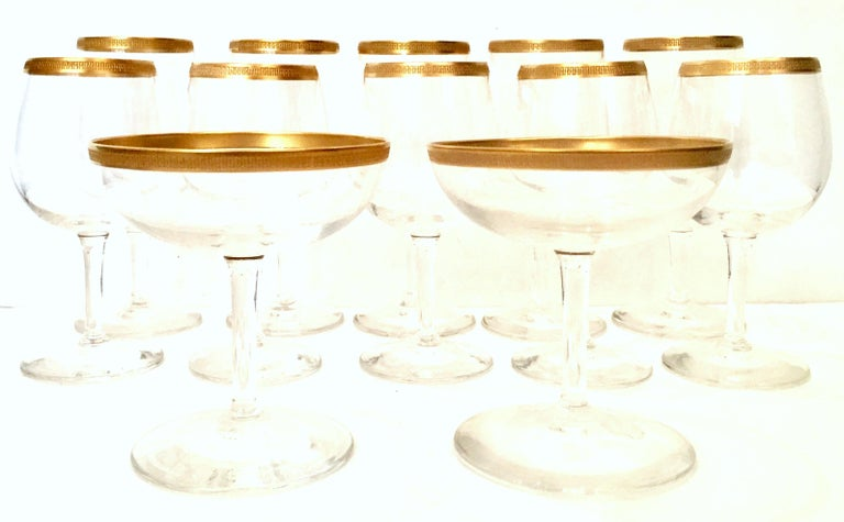 20th Century Italian crystal and 22-karat stem drinking glasses, set of 12. Set Includes, five large goblets, five small goblets and two coupe style glasses.  Dimensions: Small goblet: 5