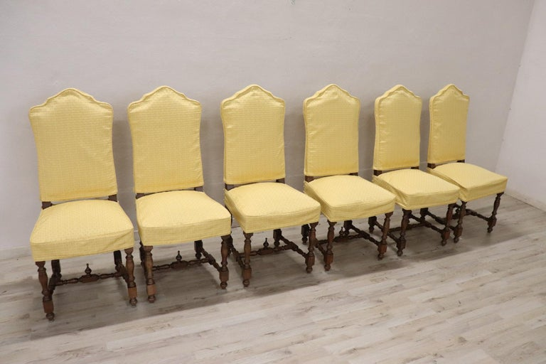Series of six refined mid-20th century Italian Louis XIV style walnut wood chairs. The legs with turned decorations. Each chair has a protective yellow fabric that can be removed for washing. Perfect for a dining table. Beautiful chairs ready to be