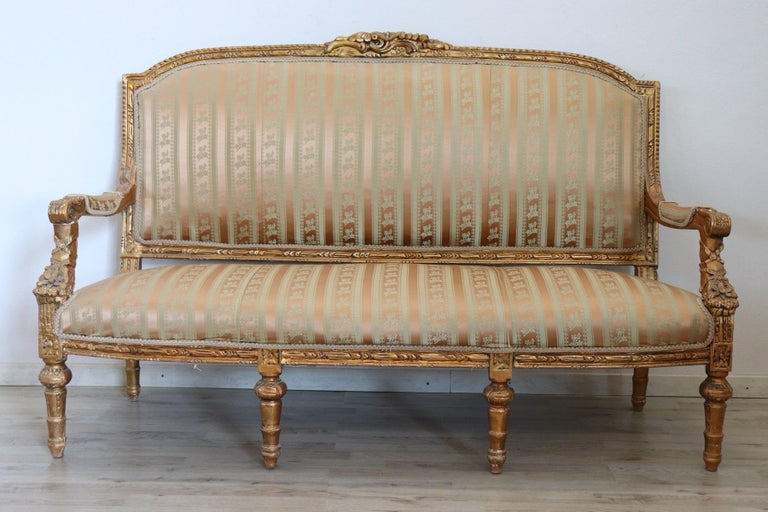 Rare complete Italian luxury Louis XVI style living room set includes: 1 large sofa 2 armchairs Refined living room set in carved and gilded wood . Excellent condition of the wood used small sign of use. The living room comes from an important