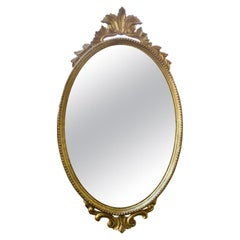 20th Century Italian Oval Giltwood Mirror with Plume