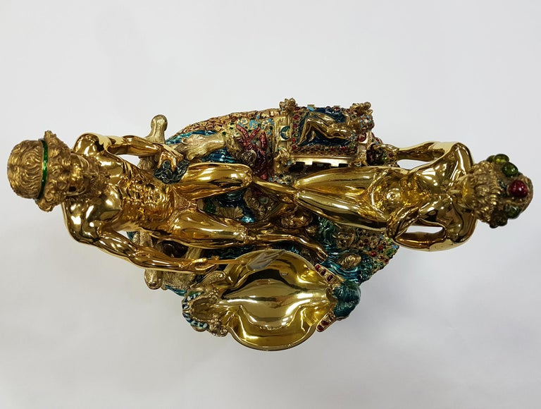 Fantastic reproduction of the famous saltcellar of Benvenuto Cellini, symbol of the world goldsmith's art. The master goldsmith made only very few copies of this wonderful object that makes it a unique piece in the world. 6.641 grams of solid