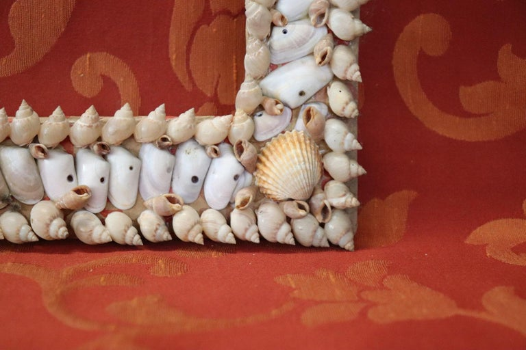 Italian Artistic photo frame made entirely with small shells. Ideal for decorating the walls of a beach house. Glued on cardboard. Sold in the conditions as photos do not have glass and wall hooking. Possible some small missing shell.