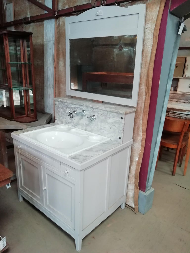 20th century Italian painted wood mirrored cupboard sink with Carrara marble top and original ceramic sink, 1940s The sink and marble have traces of use but they are in good vintage conditions wear consist with age and use.