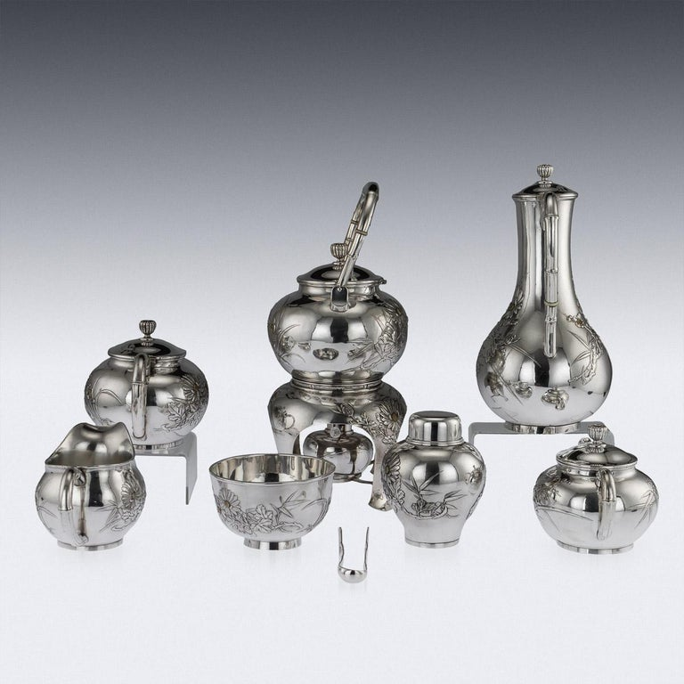 Antique early 20th century Japanese Meiji period solid silver massive eight-piece tea and coffee service, exceptional and magnificent quality, embossed and applied with chrysanthemum flowers, blossoming cherry trees on matted ground, flowers