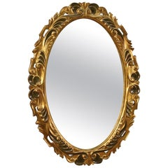 20th Century Lacquered and Giltwood and Plaster Italian Oval Mirror, 1960