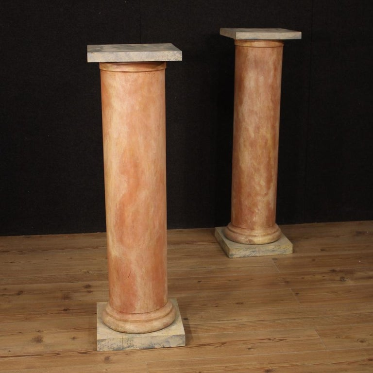 Pair of French columns from the 20th century. Furniture in sculpted and lacquered fake marble wood of great size and pleasant decor. Columns that offer a top of 32 cm per side, of good service. Ideal furniture to exhibit sculptures or vases with