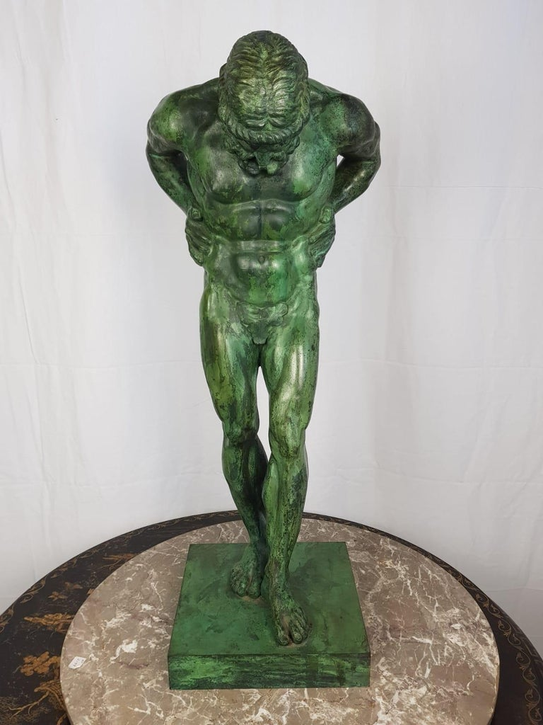 Atlas bronze of excellent casting and definition standing in and unusual pose with hands on his hips and normally with a globe on his shoulders in this depiction it is Atlas alone. A stunning green patina. Would create an atmosphere of strong