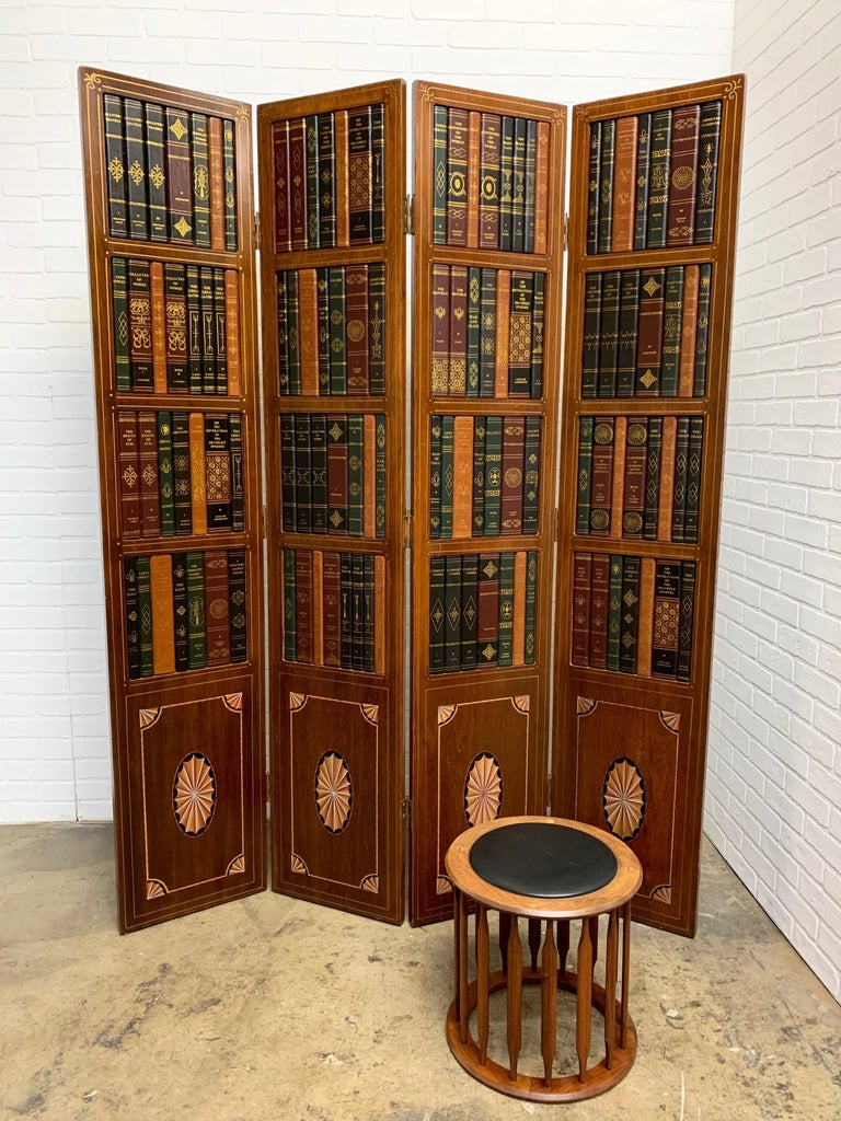 4 panel screen with faux books on the upper panel and inlaid marquetry on the lower panels with some hand painted details.