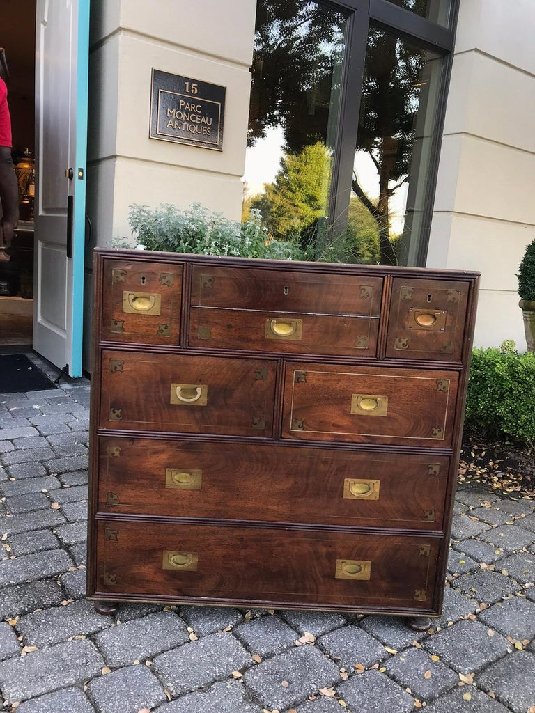 20th century mahogany Campaign style secretary chest with brass inlay and mounts Labeled