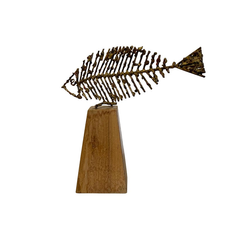 A vintage Mid-Century Modern Italian abstract metal sculpture, a fish on a wood base, signed by Marcello Fantoni, in good condition. As seen in the Metropolitan Museum of Art, Brooklyn Museum and the Victoria Albert Museum in London. Wear consistent
