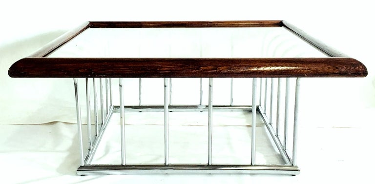 Mid-Century Modern Milo Baughman style bent tubular chrome spoke base coffee table with wood stained mahogany trim and original smoked glass top.